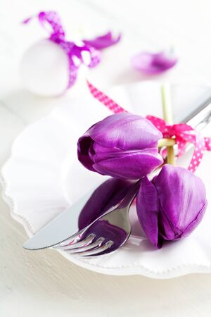 table setting for easter with tulips  photo