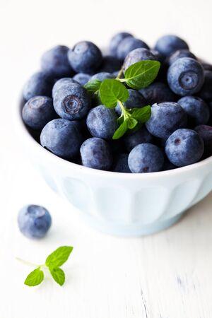 bilberries: fresh bilberries in blue bowl  Stock Photo