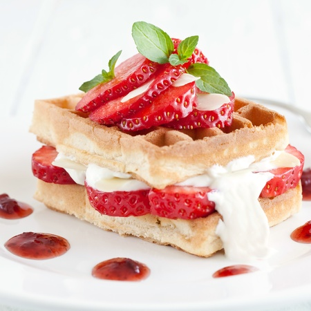 waffles: waffle with strawberries and whipped cream