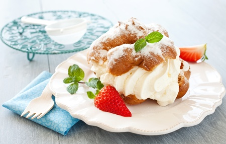 fresh cream puff with whipped cream and strawberries