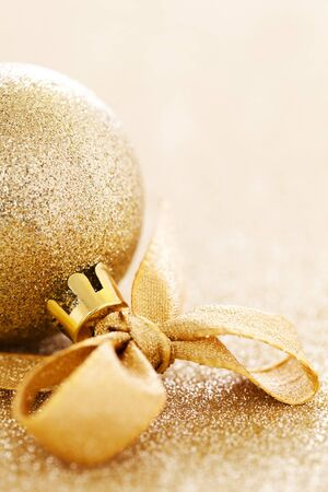 golden christmas bauble with ribbon and copy space  photo