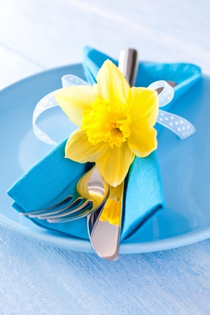 easter table setting with daffodil and cutlery  photo