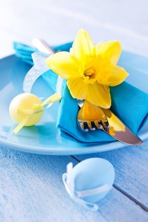 table setting with daffodil and easter eggs
