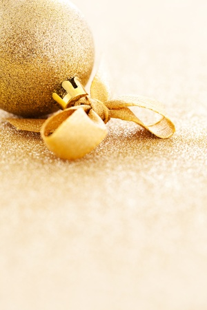 christmas ornament with ribbon on gold with copy space  Stock Photo - 13329393