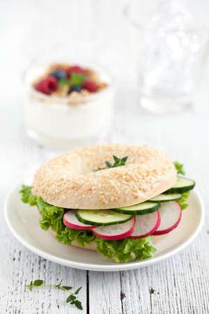 bap: fresh bagel with radish and cucumber  Stock Photo