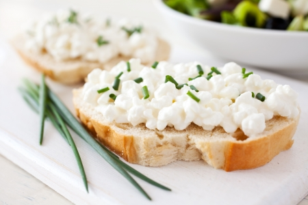 fresh baguette with curd and chives photo