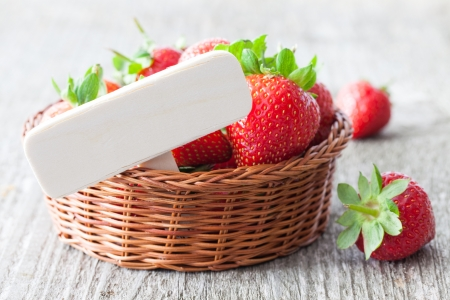 strawberries with wooden tag in a basket  photo