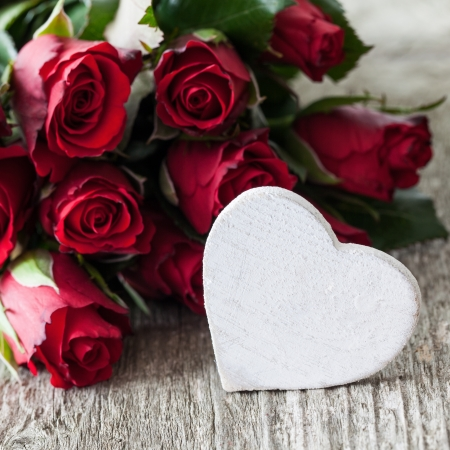 red roses and heart shape with copy space