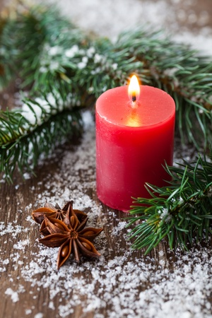 burning time: red christmas candle with fir
