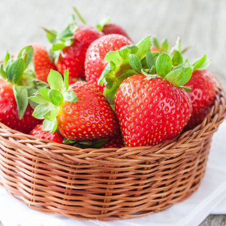 fresh juicy strawberries in a basket photo