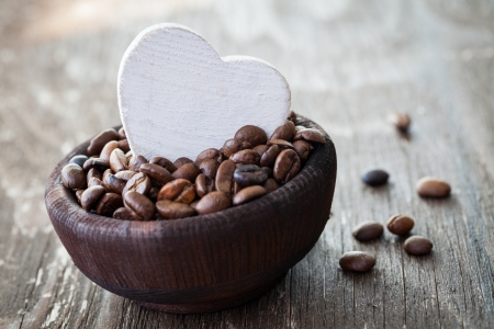 fresh coffee beans in a wooden bowl  photo