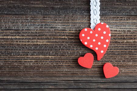 valentin day: heart shape on wooden background