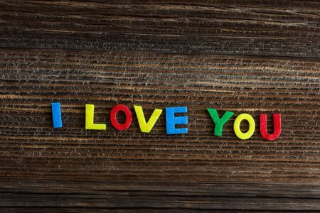 love you: i love you text on wooden background