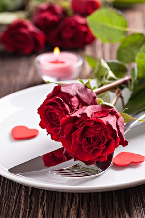 table setting for valentines day with roses  photo
