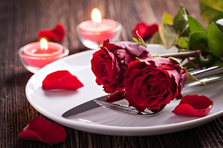 romantic dinner: table setting for valentines day with roses  Stock Photo