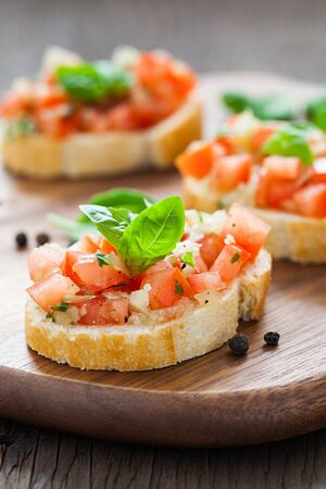 bruschetta on wooden board with pepper photo