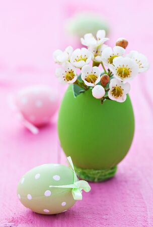 easter greetings with flowers and easter eggs   photo