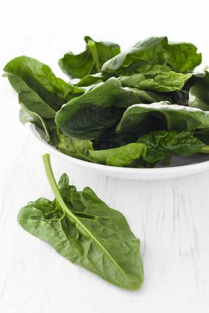 spinach salad: fresh spinach in a bowl