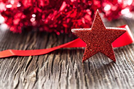christmas time: red star shape on wooden background