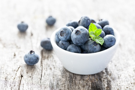 berry fruit: blueberries in a bowl on wood
