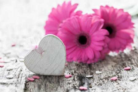 Gerbera: heart shape and gerbera on wood