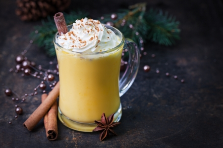 eggnog: eggnog with whipped cream and cinnamon  Stock Photo