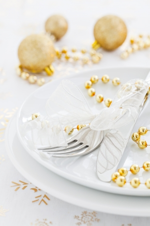 table setting for christmas with golden decoration   photo