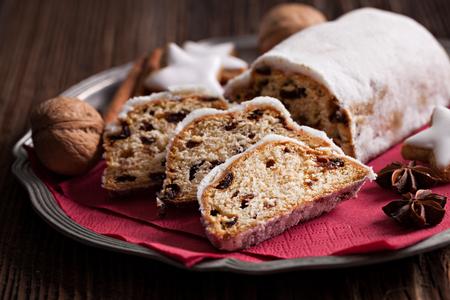 christmas cake: raisin stollen german cake on a plate
