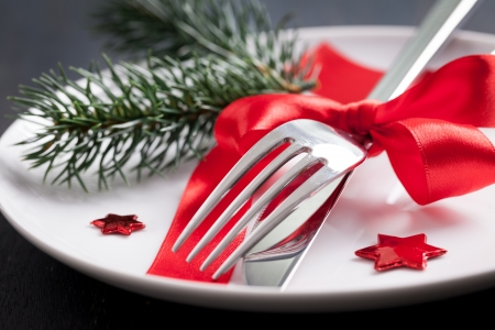 table setting for christmas with red ribbon   photo