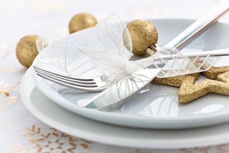 christmas dinner with golden decoration photo