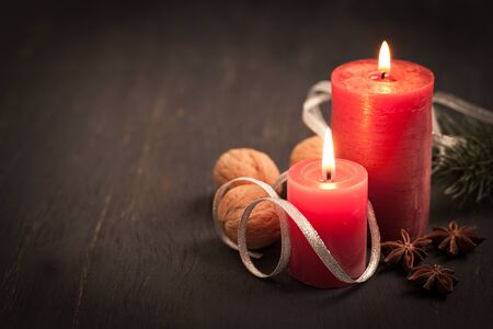 christmas card with candles and spices   photo