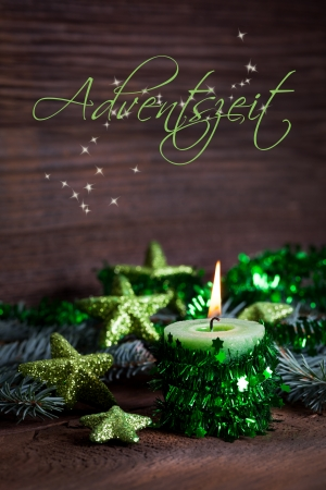 advent time with burning candle and decoration photo
