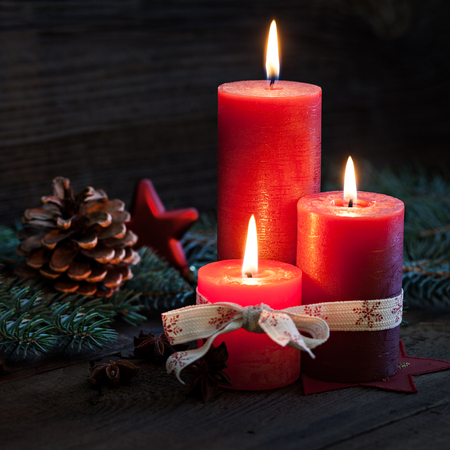 candle lights: three candles with christmas decoration