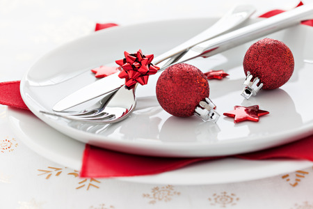 place setting with red baubles  photo