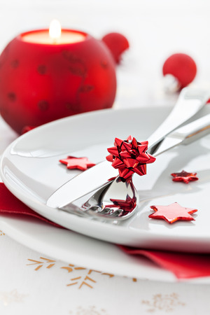 place setting with candle and cutlery  photo