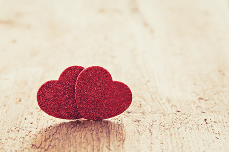 two hearts on wood with copy space