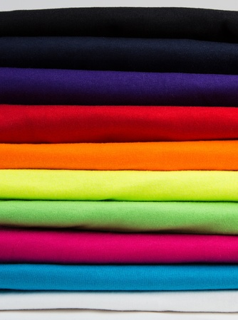 neatly: Closeup of colorful new shirts stacked neatly