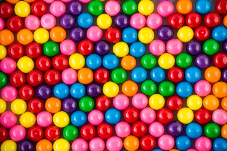 bubblegum: Brightly colored gum balls laying flat, background