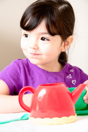 playing with spoon: Gorgeous Toddler Takes a huge gulp at the tea party