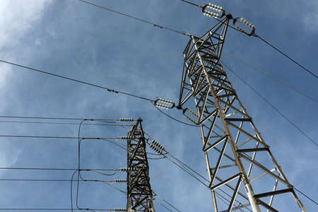 High Voltage Poles under blue Sky Stock Photo - 8437304