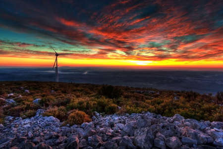 windy energy: Powerful Sunset near a Eolic Park - Portugal Stock Photo