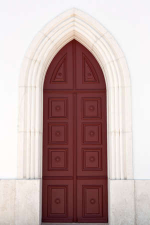 Portrait view of an old main door of a church   photo