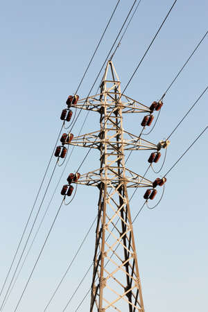 Vertical perspective of power lines under blue sky photo