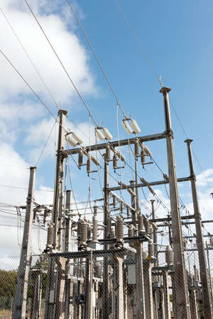 High Voltage Sub-Station against blue sky and clouds Stock Photo - 9401965