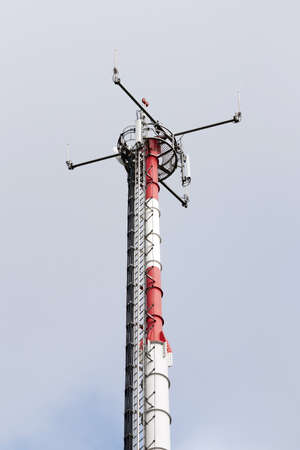 comunication: Mobile phone comunication tower against cloudy sky  Stock Photo