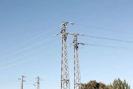 derivation: A derivation of some high voltage pylons near a sub-station.