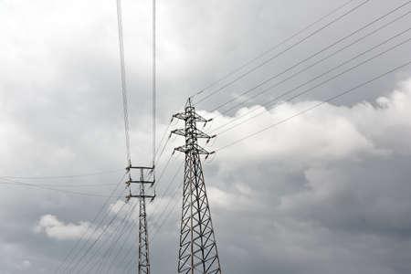 derivation: High Voltage Pylon Derivation against cloudy sky Stock Photo