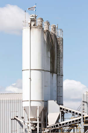 A group of processing silos of a concrete factory photo