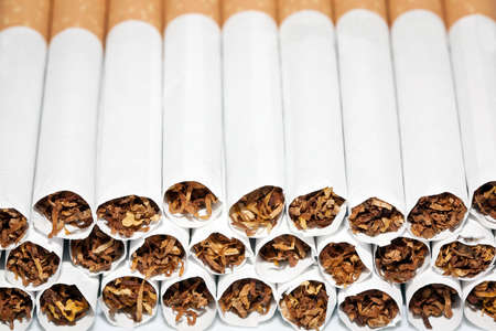 Close up of a smoking cigarettes in a stack photo