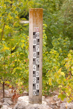 Water level gauge against plants and trees Stock Photo - 10555095